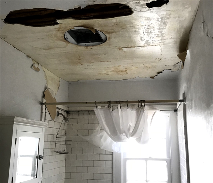Ceiling water damage from pipe burst in Amherst, OH